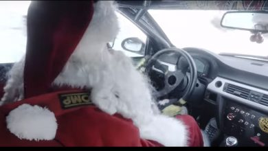 Santa Claus on car babbo Natale-drive