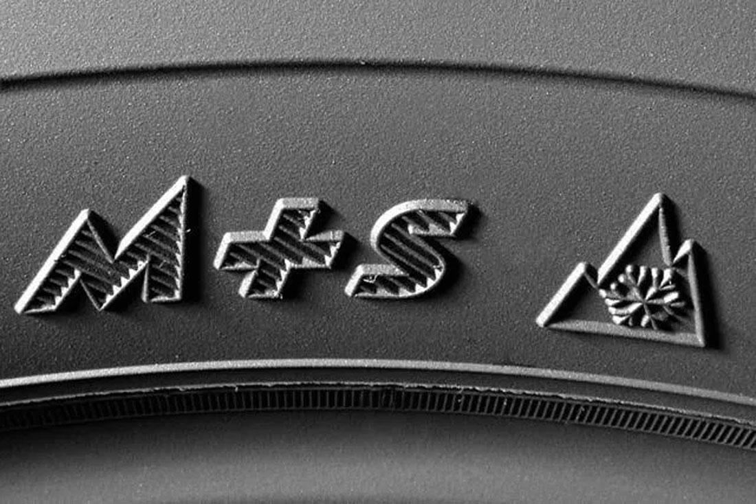 logo M+S e fiocco simboli su gomma invernale